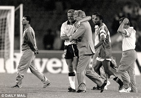 embracing Paul Gascoigne - masterminded England's 3-2 quarter-final win over Cameroon at Italia 1990