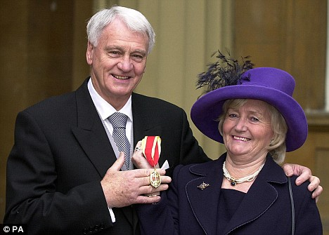 Knight to remember: A proud Sir Bobby Robson displays his Knighthood at Buckingham Palace with his wife Elsie in 2002