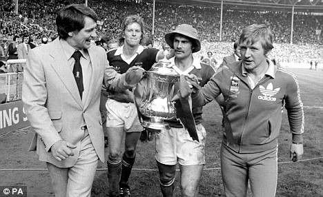 Robson celebrates guiding Ipswich to to the FA Cup in 1978 with coach Cyril Lea and players David Geddis and captain Mick Mills